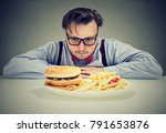 young chunky man in eyeglasses... | Shutterstock . vector #791653876