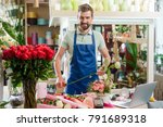 male florist in flower shop.... | Shutterstock . vector #791689318