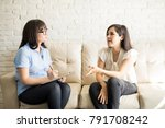pretty young woman talking to... | Shutterstock . vector #791708242