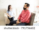 handsome young man is sitting... | Shutterstock . vector #791756602