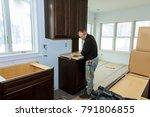 contractor installing a... | Shutterstock . vector #791806855