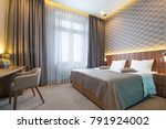 Stock photo interior of a modern hotel bedroom 791924002