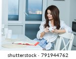 young woman reading a book at... | Shutterstock . vector #791944762
