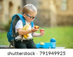 cute schoolboy eating outdoors... | Shutterstock . vector #791949925