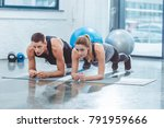 sporty young couple doing plank ... | Shutterstock . vector #791959666