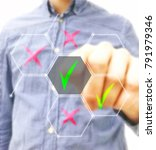 Small photo of Hand choosing from holographic screen right answer. Business and success concept plan.