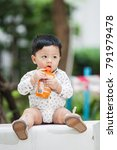 the cute boy in the garden ... | Shutterstock . vector #791979478