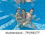 Underwater Family In Swimming...