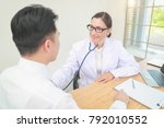 doctor checking male patient... | Shutterstock . vector #792010552