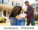 man filling recycling bin on... | Shutterstock . vector #792014446