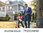 businessman father walking son...   Shutterstock . vector #792014848