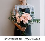 Young Florist Woman Holding...