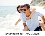 Happy Young Couple Enjoying A...
