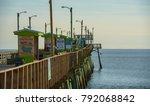 Small photo of Emerald Isle, NC/US-Dec 26 2017:Bogue Inlet fishing pier on the Atlantic Ocean