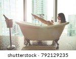 seductive woman taking relaxing ...   Shutterstock . vector #792129235