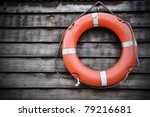 Life Buoy attached to a Wooden Paneled Wall with Plenty of Copy Space - stock photo