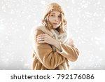 the girl in beige coat and cap... | Shutterstock . vector #792176086