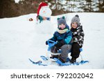 two little happy boys sledding... | Shutterstock . vector #792202042