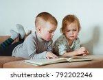 two little boys reading a book... | Shutterstock . vector #792202246
