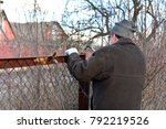 welder makes a fence in the... | Shutterstock . vector #792219526
