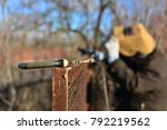 welder makes a fence in the... | Shutterstock . vector #792219562