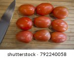 roma tomatoes on wood cutting...   Shutterstock . vector #792240058