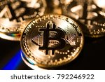 bitcoin. golden bitcoins on the ... | Shutterstock . vector #792246922
