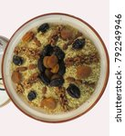 Small photo of traditional Algerian couscous with dried fruits for Berber New Year's Day.