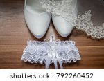 shoes and garter of the bride | Shutterstock . vector #792260452