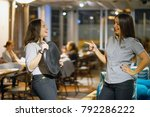 two cheerful waitresses gossip... | Shutterstock . vector #792286222
