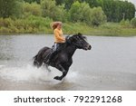 young lady rider galloping... | Shutterstock . vector #792291268