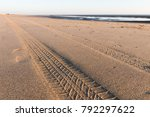 tyre tracks going off in the... | Shutterstock . vector #792297622