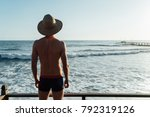 the guy in the hat standing on... | Shutterstock . vector #792319126