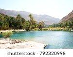 Sun shining on beautiful desert lake oasis of Wadi Bani Khalid in Oman