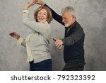 happy stylish elderly couple... | Shutterstock . vector #792323392
