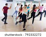cheerful men women performing...   Shutterstock . vector #792332272