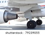 Engines and rear wheels/undercarriage of a modern public transport aircraft - stock photo