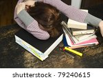 female asleep or resting at library table - stock photo