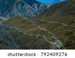 Small photo of Rugged mountain road bend bend bend