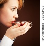 Five-o'clock tea. White collar woman relaxing with hot tea - stock photo