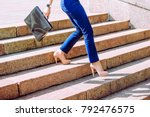 legs of businesswoman go down...   Shutterstock . vector #792476575