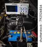 Small photo of car diagnostic: connect the oscilloscope to the engine