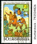 Small photo of Ukraine - circa 2018: A postage stamp printed in Mongolia shows Wrestling, Mongolian National Sport. Series: International Decade for Women. Circa 1981