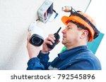 technician worker installing... | Shutterstock . vector #792545896