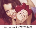 beautiful woman with two red... | Shutterstock . vector #792551422
