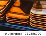 the plates of wood on the shelf.... | Shutterstock . vector #792556702