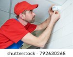 worker installing or adjusting... | Shutterstock . vector #792630268