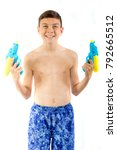 Young teenage boy playing with water guns isolated on a white background - stock photo