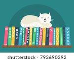 books on shelf with white cat.... | Shutterstock .eps vector #792690292