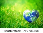 Earth in Heart shape on green grass on sunlight, Love and Save the World for the Next Generation concept, Earth day concept, Elements of this image furnished by NASA